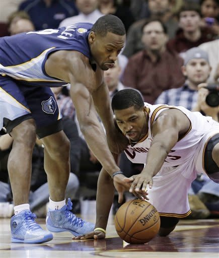 Memphis Grizzlies' Tony Allen, left, and Cleveland Cavaliers' Tristan Thompson battle for a loose ball during the first quarter of an NBA basketball game Friday, March 8, 2013, in Cleveland. (AP Photo/Tony Dejak)