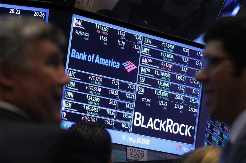 File photo of a screen displaying the trading price for Bank of America and Black Rock stocks on the floor of the New York Stock Exchange