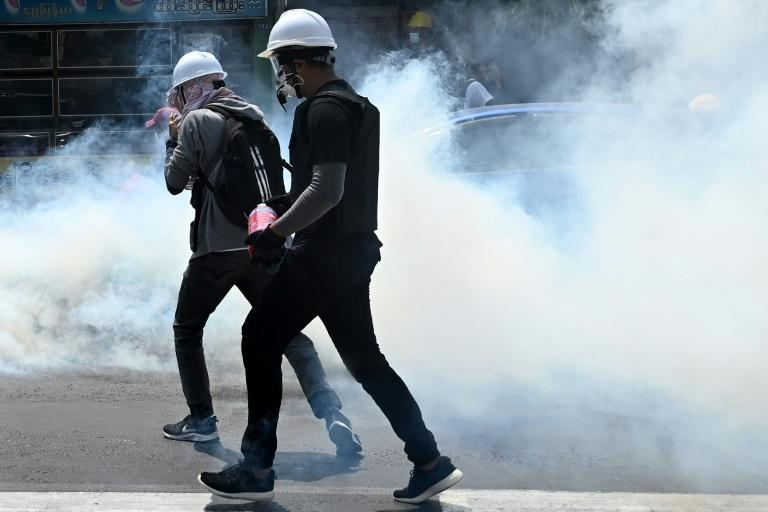 Police fired tear gas to disperse protesters in parts of Yangon