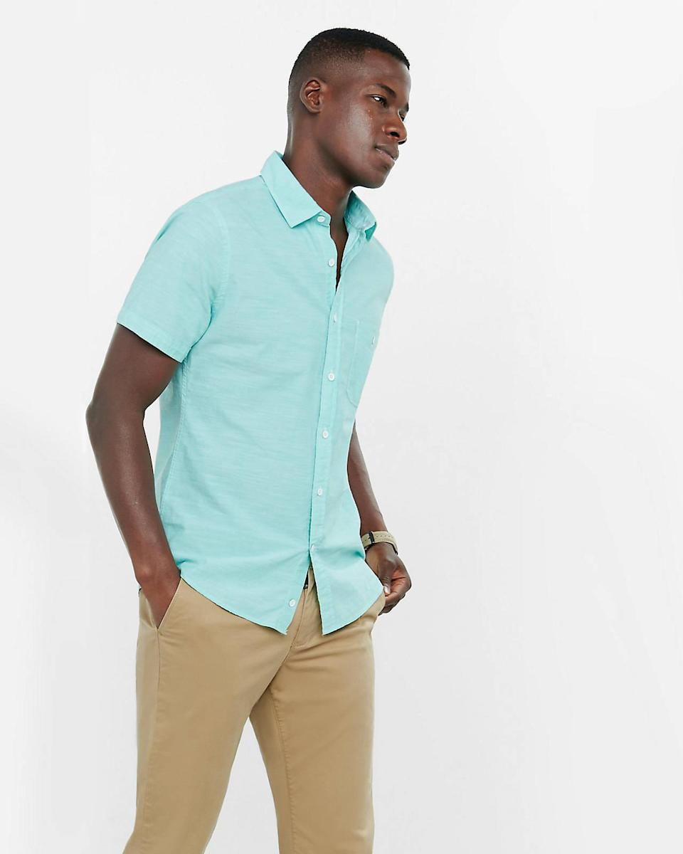 "<p>Summer dressing never looked as easy and breezy as this lightweight chambray shirt in a bright pop of sea foam green. <i>($50 <a href=""http://www.express.com/clothing/men/short-sleeve-slub-chambray-shirt/pro/5572233/cat2060009"" rel=""nofollow noopener"" target=""_blank"" data-ylk=""slk:via Express"" class=""link rapid-noclick-resp"">via Express</a>)</i></p>"