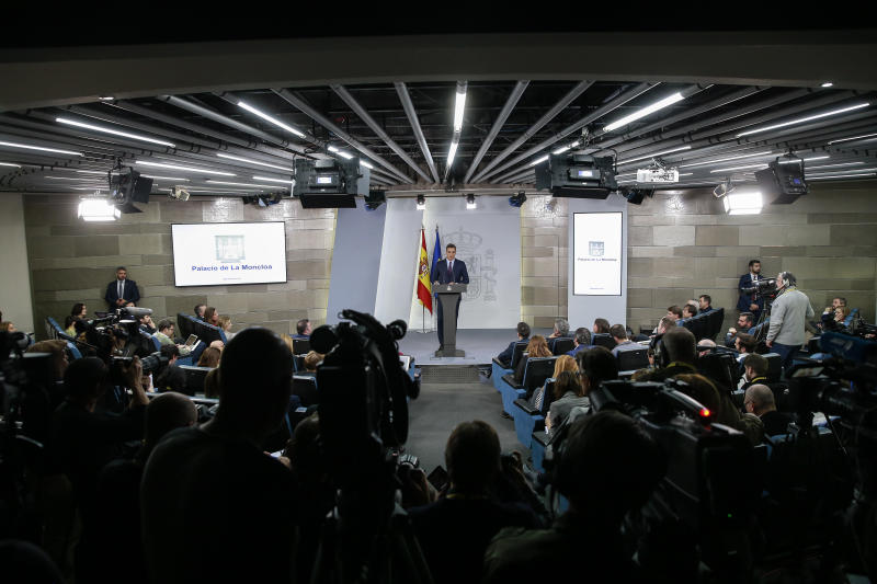 Watched by the media Spain's Prime Minister Pedro Sanchez delivers a statement at the Moncloa Palace in Madrid, Spain, Friday, Feb. 15, 2019. Sanchez has called early general elections for late April, the third such ballot in less than four years. (AP Photo/Andrea Comas)