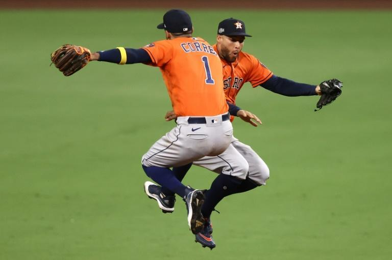 Carlos Correa and George Springer celebrate the Houston Astros' series-extending 7-4 victory over the Tampa Bay Rays in game six of baseball's American League Championship Series