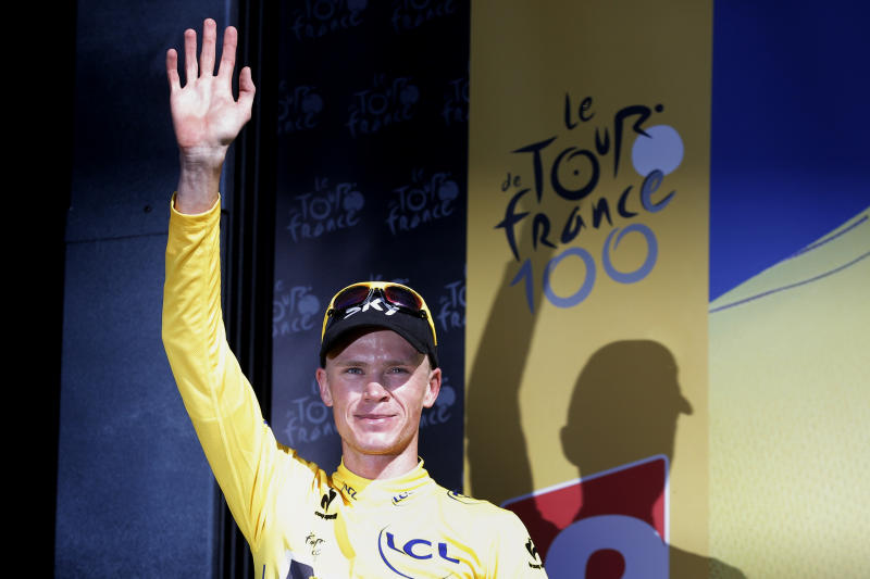 Christopher Froome of Britain, wearing the overall leader's yellow jersey, celebrates on the podium of the 20th stage of the Tour de France cycling race over 125 kilometers (78.1 miles) with start in in Annecy and finish in Annecy-Semnoz, France, Saturday July 20 2013. (AP Photo/Christophe Ena)