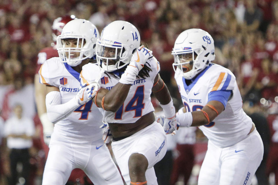 Boise State cornerback Tyler Horton (14) got to sit on the turnover throne in Week 1. (AP Photo/Young Kwak)