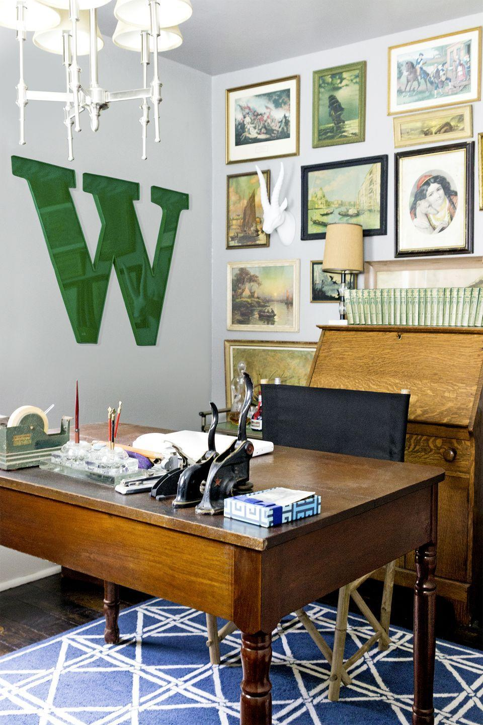 <p>Part office, part art gallery: Surround your desk with inspiring prints and artwork, complete with mismatched frames. </p>