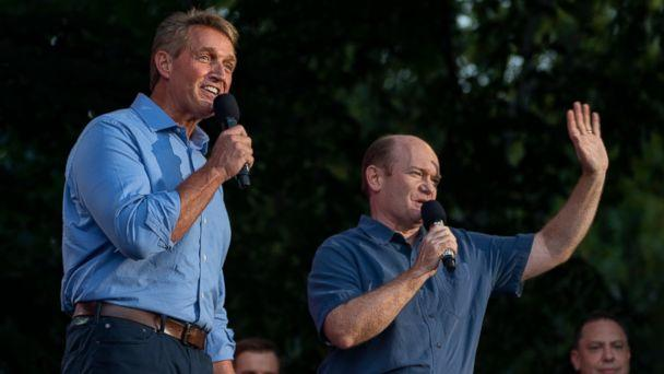 PHOTO: Jeff Flake, R-Ariz., left , and Sen. Chris Coons, D-Del, stand together as they address festival participants during the 2018 Global Citizen Festival Saturday, Sept. 29, 2018, in New York. (AP)