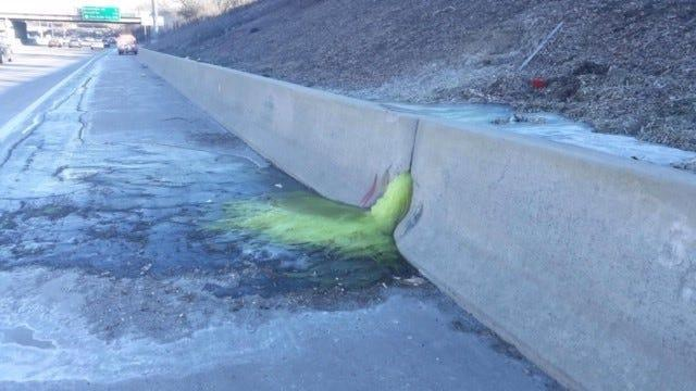 A greenish-yellow liquid flows through a retaining wall on I-696, triggering a lane closure Friday afternoon and hazmat cleanup Friday night, Dec. 20, 2019.