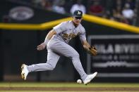 Oakland Athletics third baseman Matt Chapman chases down a grounder hit by Arizona Diamondbacks' Tim Locastro before throwing to second base for a force out during the second inning of a baseball game Tuesday, April 13, 2021, in Phoenix. (AP Photo/Ross D. Franklin)