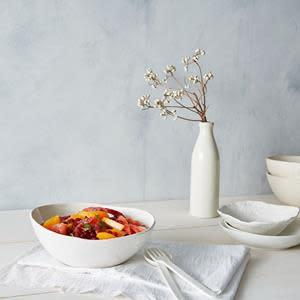 The Jars WABI collection was inspired by the Japanese philosophy WABI SABI, which blends the imperfect beauty created by craftsmanship along with nature's simplicity. This stoneware collection, made in France, offers the effortless grace of asymmetry and roughness. Each piece combines the natural stoneware material with ash glazes to make each piece unique and a work of art.