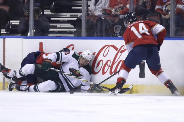 Minnesota Wild left wing Jordan Greenway (18) and Florida Panthers center Dominic Toninato (14) go for the puck during the first period of an NHL hockey game, Tuesday, Dec. 3, 2019, in Sunrise, Fla. (AP Photo/Lynne Sladky)