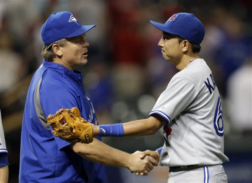 Toronto Blue Jays manager John Gibbons, left, congratulates Munenori Kawasaki after Toronto's 5-4 win over the Cleveland Indians in a baseball game Wednesday, July 10, 2013, in Cleveland. (AP Photo/Mark Duncan)