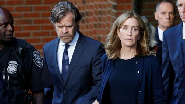 PHOTO: Actress Felicity Huffman leaves the federal courthouse with her husband William H. Macy, after being sentenced in connection with a nationwide college admissions cheating scheme in Boston, Mass., September 13, 2019. (Katherine Taylor/Reuters)