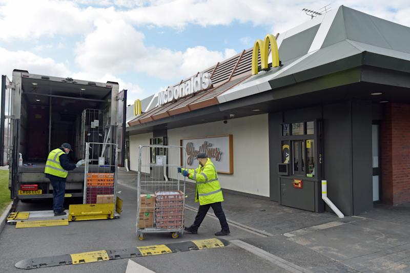Staff members organise a delivery at a branch of McDonald's at Boreham, near Chelmsford in Essex, which one of 15 of the restaurant chain's locations which are reopening for delivery meals.