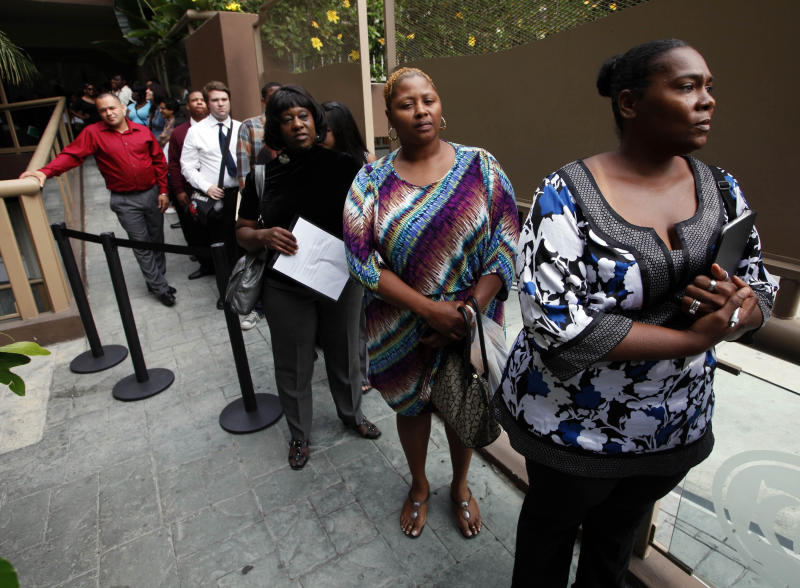 FILE - In this Friday, Aug. 17, 2012 file photo, Sheila Bird, right, waits in line for employment interviews at a job fair at City Target in Los Angeles. The Labor Department said Friday, Sept. 21, 2012, that unemployment rates rose in 26 states last month, the latest evidence that hiring remains tepid across the country. (AP Photo/Nick Ut, File)