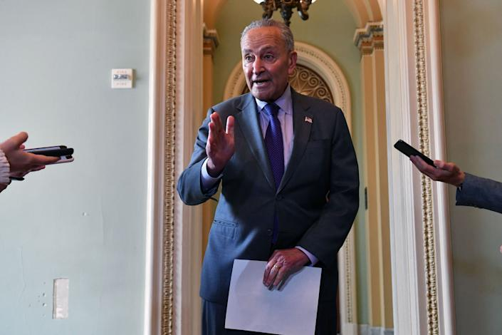 US Senate Majority Leader Chuck Schumer (C) addresses the press on the infrastruture package at the US Capitol, in Washington, DC on July 28, 2021. (Nicholas Kamm/AFP via Getty Images)