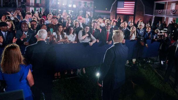 PHOTO: President Donald Trump and Vice President Mike Pence greet the crowd after Pence's acceptance speech during an event of the 2020 Republican National Convention held at Fort McHenry in Baltimore, Aug. 26, 2020. (Jonathan Ernst/Reuters)