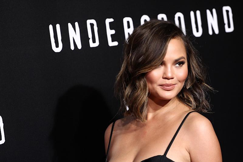 Chrissy Teigen's drapey, golden gown is the stuff of goddess-filled dreams