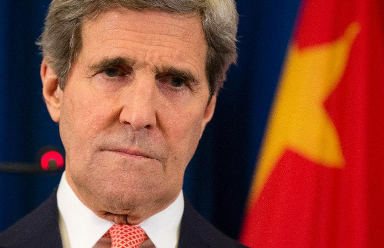 US Secretary of State John Kerry listens to a question during a news conference in Beijing on February 14, 2014