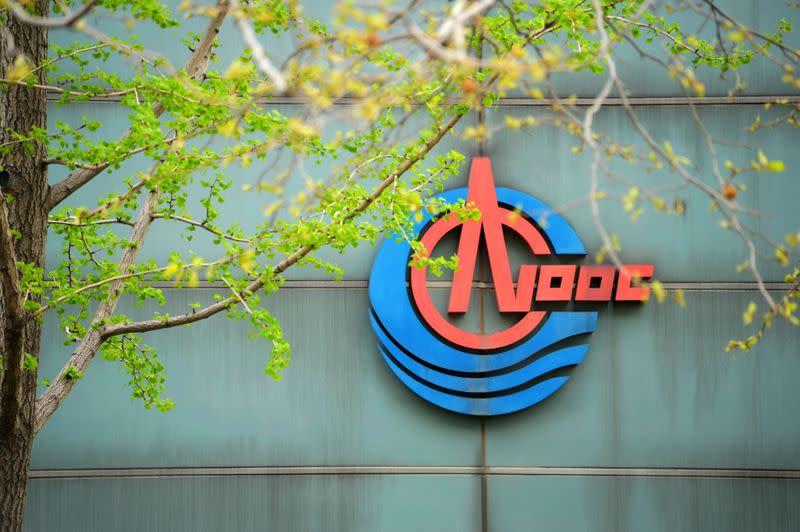 FILE PHOTO: The logo of China National Offshore Oil Corp (CNOOC) is pictured at its headquarters in Beijing