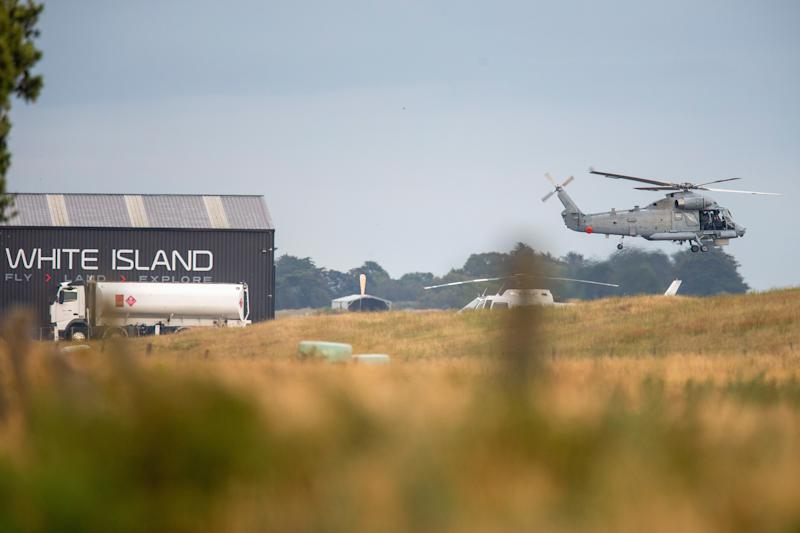 A military helicopter departs Whakatane airport during the recovery. Source: AAP