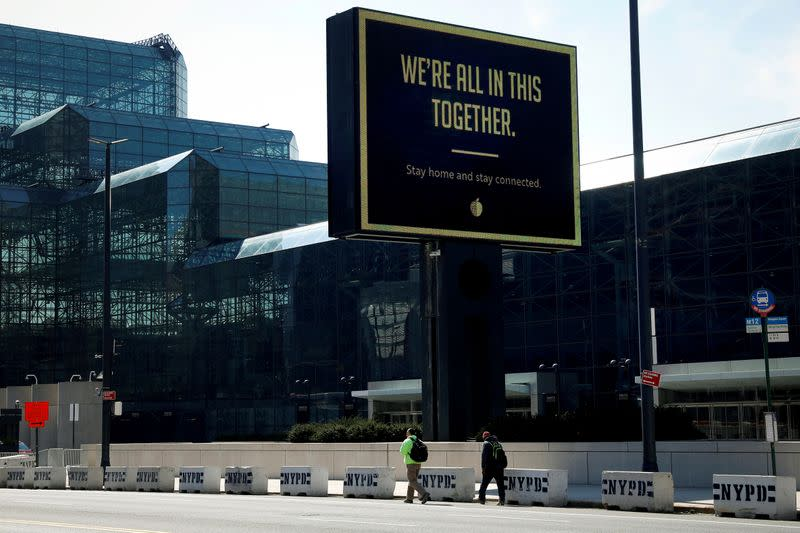 FILE PHOTO: A sign displays a message outside the Jacob K. Javits Convention Center which is being partially converted into a temporary hospital in Manhattan during the outbreak of the coronavirus disease (COVID-19) in New York