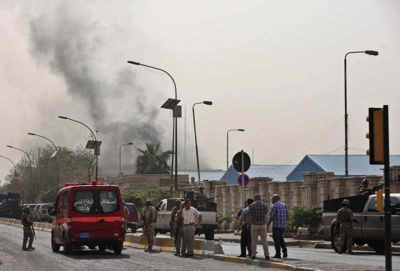 Black smoke from a car bomb attack is seen in Baghdad, Iraq, Thursday, March, 14, 2013. A string of explosions tore through central Baghdad within minutes of each other on Thursday, followed by what appeared to be a coordinated assault by gunmen who battled security forces in the Iraqi capital, according to officials. Authorities say more than a dozen have been killed. (AP Photo/Karim Kadim)
