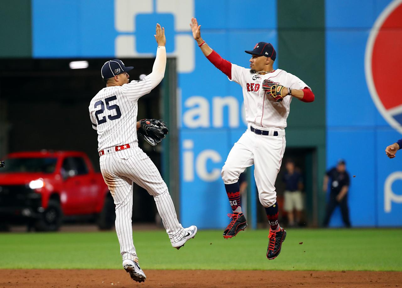 Gleyber Torres #25 of the New York Yankees and the American League celebrates with Mookie Betts #50 of the Boston Red Sox and the American League after defeating the National League All-Stars 4-3 in the 2019 MLB All-Star Game, presented by Mastercard at Progressive Field on July 09, 2019 in Cleveland, Ohio. (Photo by Gregory Shamus/Getty Images)