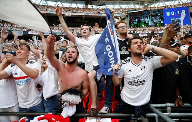 "Soccer Football - Championship Play-Off Final - Fulham vs Aston Villa - Wembley Stadium, London, Britain - May 26, 2018 Fulham fans celebrate promotion to the Premier League Action Images via Reuters/Carl Recine EDITORIAL USE ONLY. No use with unauthorized audio, video, data, fixture lists, club/league logos or ""live"" services. Online in-match use limited to 75 images, no video emulation. No use in betting, games or single club/league/player publications. Please contact your account representative for further details."