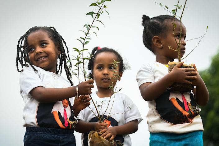 Young Ethiopian girls take part in a national tree-planting drive in the capital, Addis Ababa. (Photo: Michael Tewelde/AFP/Getty Images)