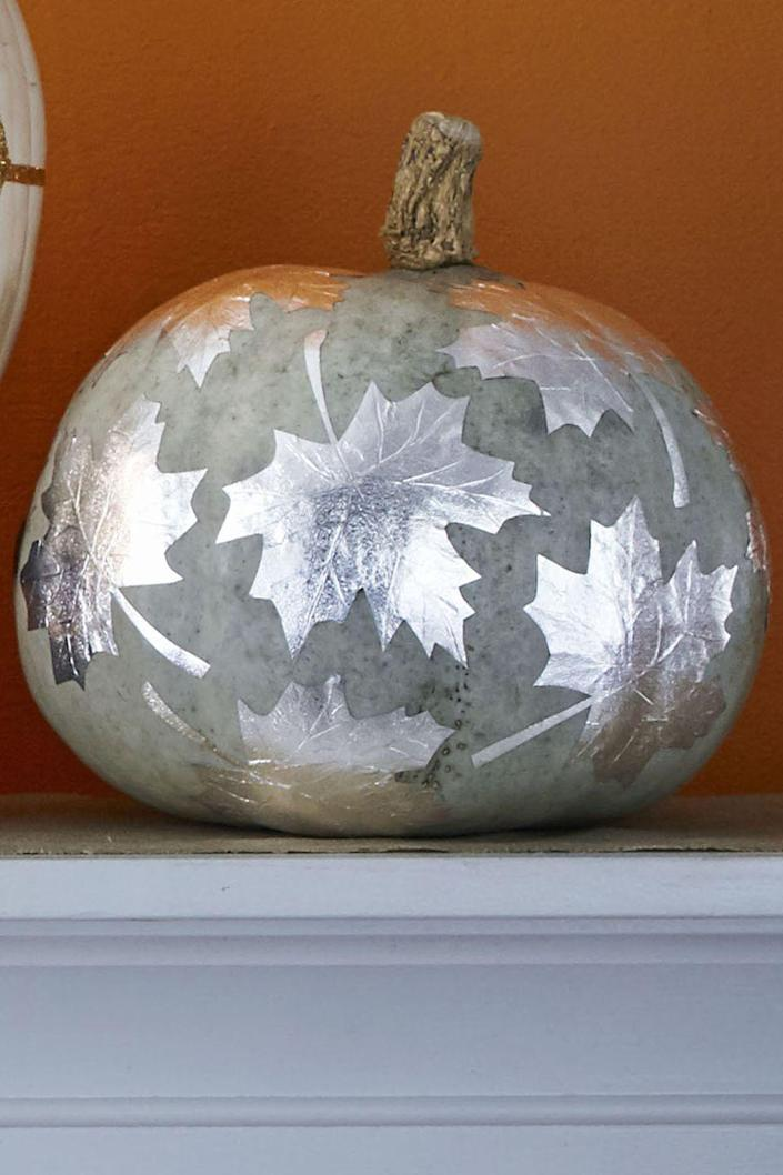 """<p>Have the kids pick the biggest, best-looking leaves from the lawn. Gently trace a leaf onto silver Fanci-Foil Wrap, then cut out and repeat (or fold foil first to cut multiple leaves at once). Use Mod Podge to adhere leaves onto a painted pumpkin. Etch leaf veins with toothpick while wet or dry. </p><p> <a class=""""link rapid-noclick-resp"""" href=""""https://www.amazon.com/Wilton-804-167-Silver-Fanci-Foil-Wrap/dp/B0000VMBB0/?tag=syn-yahoo-20&ascsubtag=%5Bartid%7C10070.g.1902%5Bsrc%7Cyahoo-us"""" rel=""""nofollow noopener"""" target=""""_blank"""" data-ylk=""""slk:SHOP Fanci-Foil Wrap"""">SHOP Fanci-Foil Wrap</a></p><p><strong>RELATED:</strong> <a href=""""https://www.womansday.com/life/g2618/fall-activities-for-families/"""" rel=""""nofollow noopener"""" target=""""_blank"""" data-ylk=""""slk:40+ Best Fall Activities for Families"""" class=""""link rapid-noclick-resp"""">40+ Best Fall Activities for Families</a></p>"""