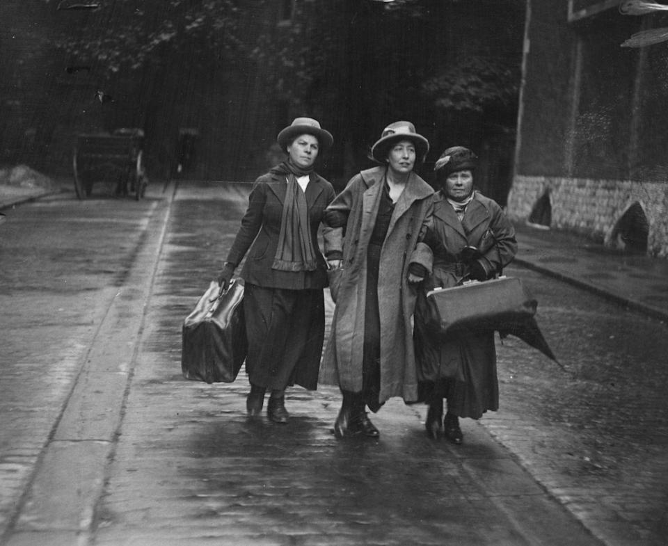 <p>A trio of women walk arm in arm shortly after British suffragette Sylvia Pankhurst (center) was released from prison. </p>