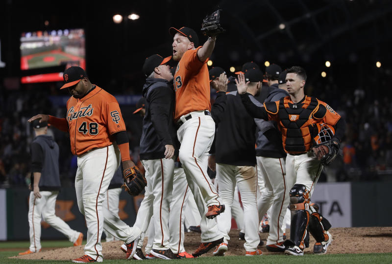 San Francisco Giants relief pitcher Will Smith, front right, celebrates with assistant hitting coach Rick Schu after the Giants defeated the Milwaukee Brewers 5-3 in a baseball game in San Francisco, Friday, June 14, 2019. (AP Photo/Jeff Chiu)