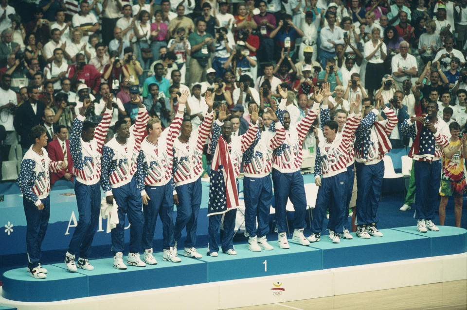 The Dream Team receives its gold medals during the 1992 Olympics – with no Reebok logos visible. (Photo by Dimitri Iundt/Corbis/VCG via Getty Images)