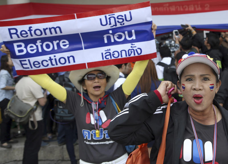 Thai anti-government protesters chant slogans during a rally in an attempt to disrupt the election registration at a sport stadium in Bangkok, Thailand Wednesday, Dec. 25, 2013. Thai Prime Minister Yingluck Shinawatra on Wednesday proposed the formation of a national reform council tasked with finding solutions to the political turmoil that is splitting the country and paralyzing governance. (AP Photo/Apichart Weerawong)
