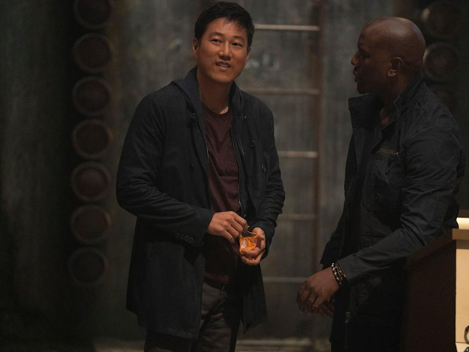 The long-awaited return of fan favourite, formerly dead Han (Sung Kang) hands him an impressive welcome and almost nothing to do afterwards (Universal Pictures)