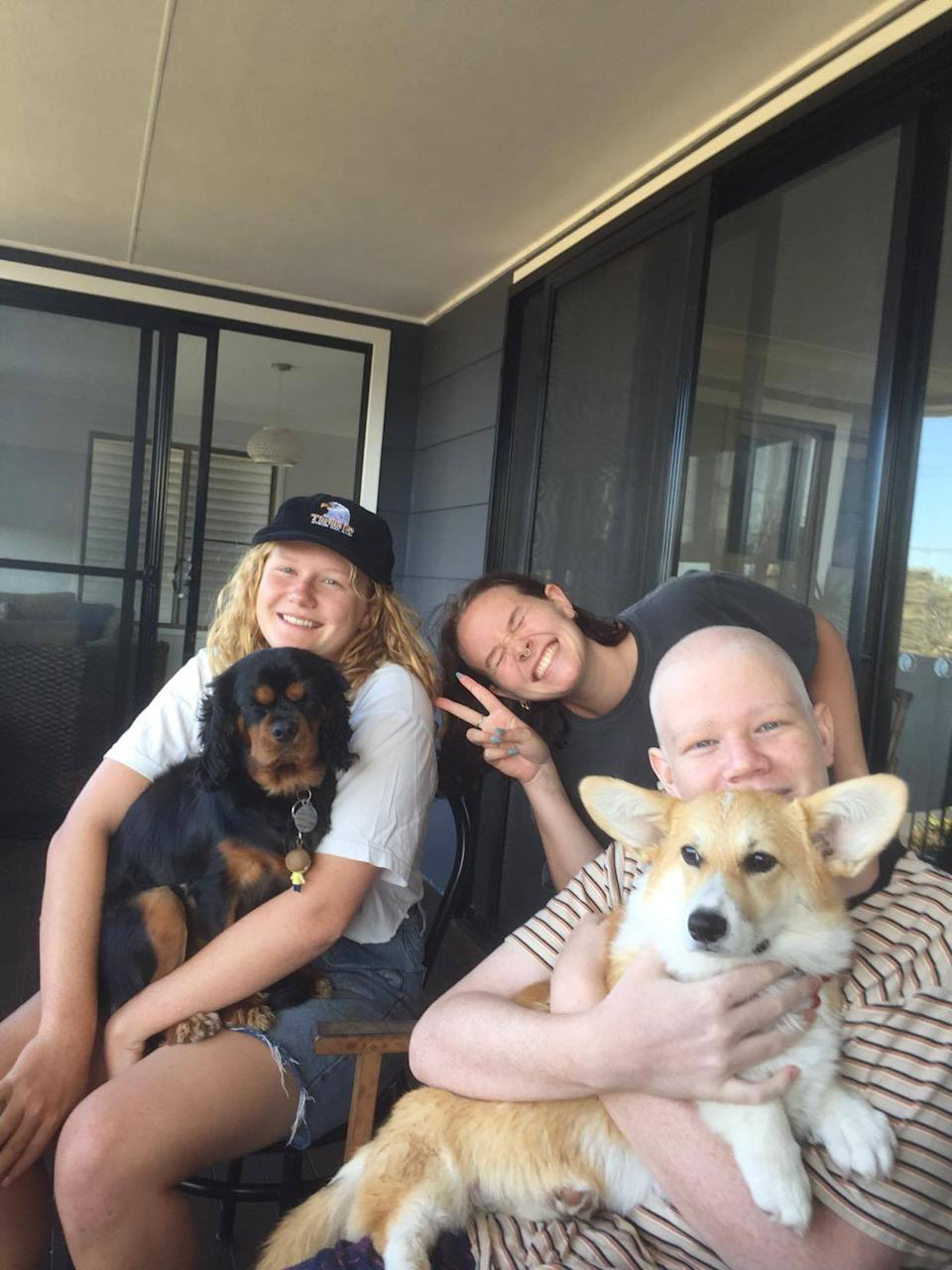 Josh is pictured with his dog Lola and two older sisters. Source: supplied