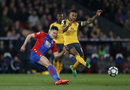 Crystal Palace's Martin Kelly in action with Arsenal's Theo Walcott