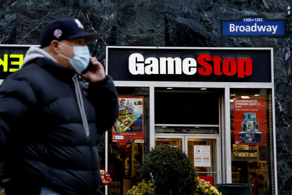 NEW YORK, NEW YORK - FEBRUARY 25: A man talks by his phone in front of GameStop at 6th Avenue on February 25, 2021 in New York. GameStop Corp. doubled its shares and and jumped another 19 percent today and the betting are that GameStop shares would spike to $800 on Friday. (Photo by John Smith/VIEWpress via Getty Images)