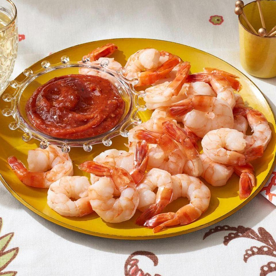 """<p>This classic appetizer will work at just about any holiday party. It's light, lemony, and serves a crowd. </p><p><a href=""""https://www.thepioneerwoman.com/food-cooking/recipes/a37756481/shrimp-cocktail-recipe/"""" rel=""""nofollow noopener"""" target=""""_blank"""" data-ylk=""""slk:Get Ree's recipe."""" class=""""link rapid-noclick-resp""""><strong>Get Ree's recipe.</strong></a></p>"""