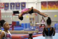 FILE - In this May 11, 2021, file photo, gymnast Jordan Chiles practices her floor routine in Spring, Texas. Three years ago, Jordan Chiles wasn't sure she wanted to be a gymnast anymore. A move to Texas, a dash of maturity and a renewed confidence in herself have the 20-year-old on the cusp of earning a spot on the U.S. Olympic team. (AP Photo/David J. Phillip, FIle)