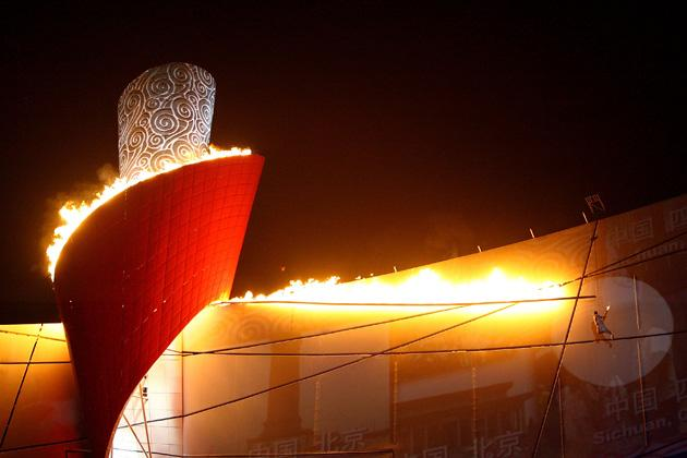 BEIJING - AUGUST 08:  The Olympic Flame is lit by former gymnast Li Ning  during the Opening Ceremony for the 2008 Beijing Summer Olympics at the National Stadium on August 8, 2008 in Beijing, China.  (Photo by Jeff Gross/Getty Images)