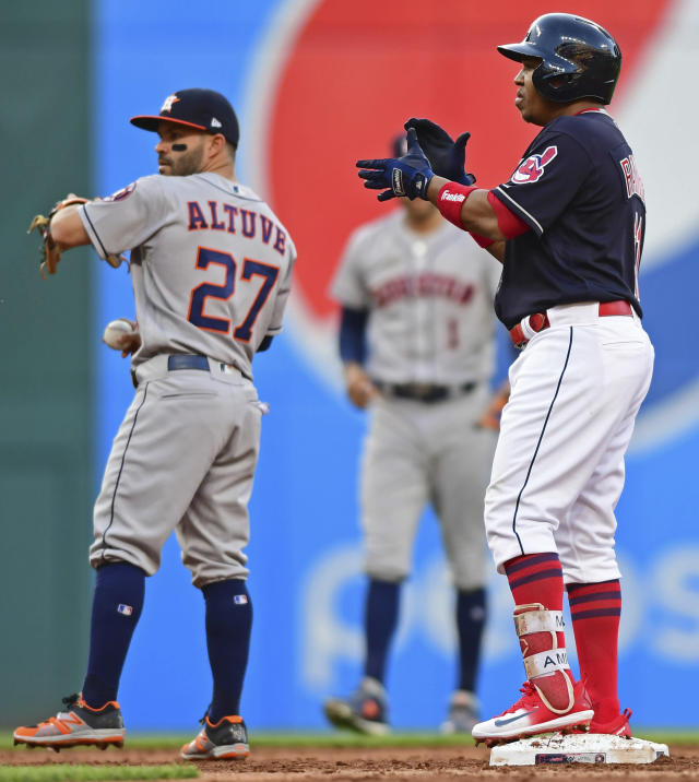 Cleveland Indians' Jose Ramirez celebrates after hitting an RBI-double during the third inning of a baseball game against the Houston Astros, Friday, May 25, 2018, in Cleveland. (AP Photo/David Dermer)