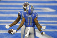 Detroit Lions wide receiver Mohamed Sanu, rear, and wide receiver Marvin Jones (11) react after Jones' touchdown during the second half of an NFL football game against the Minnesota Vikings, Sunday, Jan. 3, 2021, in Detroit. (AP Photo/Al Goldis)
