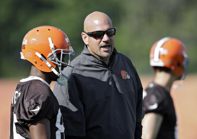 Cleveland Browns head coach Mike Pettine talks with wide receiver Chandler Jones during the first practice at the NFL football team's training camp in Berea, Ohio, Saturday, July 26, 2014. (AP Photo/Mark Duncan)