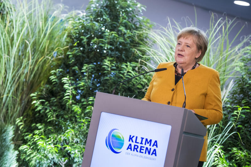 "SINSHEIM, GERMANY - OCTOBER 07: German Chancellor Angela Merkel speaks during the opening of the ""Klima Arena,"" or Climate Arena, on October 7, 2019 in Sinsheim, Germany. The Climate Arena, a project of the Dietmar Hopp Foundation, is a building meant to present visitors with the most pressing aspects of climate change as well as potential solutions. (Photo by Thomas Lohnes/Getty Images)"