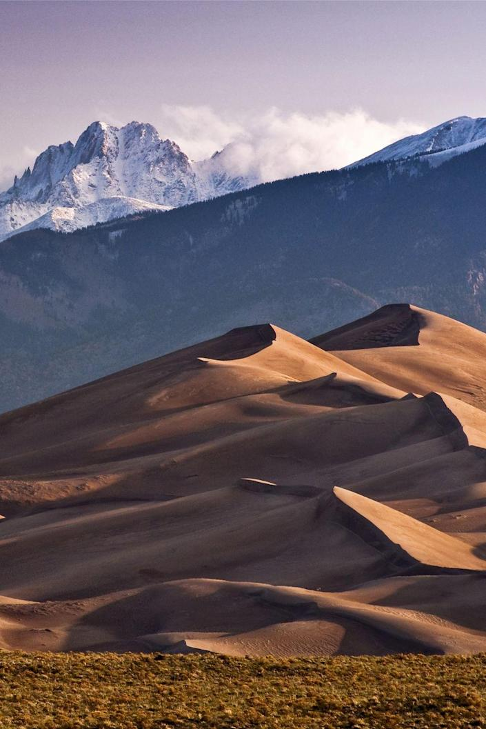 <p><strong>Where: </strong>Great Sand Dunes National Park, Colorado</p><p><strong>Why We Love It: </strong>While the Sangre de Cristo Mountains may seem to dwarf them, Colorado's Great Sand Dunes are actually the highest sand dunes in North America.</p>