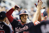 Washington Nationals' Juan Soto is cheered by the team after hitting a two-run home run in the third inning of a baseball game against the Miami Marlins, Wednesday, Sept. 22, 2021, in Miami. (AP Photo/Marta Lavandier)
