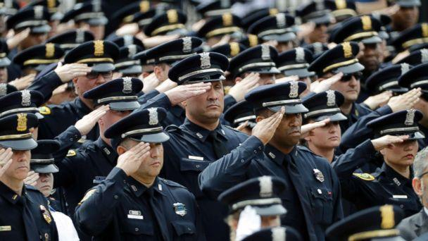 PHOTO: Houston police officers salute during a funeral service for Houston Police Sgt. Steve Perez, Sept. 13, 2017, in Houston. (David J. Phillip/AP)