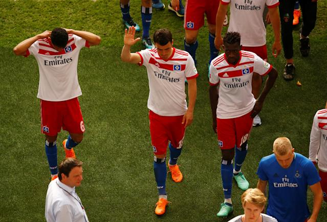 Soccer Football - Bundesliga - Hamburger SV v Borussia Moenchengladbach - Volksparkstadion, Hamburg, Germany - May 12, 2018 Hamburg's Douglas Santos and team mates look dejected at the end of the match REUTERS/Morris Mac Matzen DFL RULES TO LIMIT THE ONLINE USAGE DURING MATCH TIME TO 15 PICTURES PER GAME. IMAGE SEQUENCES TO SIMULATE VIDEO IS NOT ALLOWED AT ANY TIME. FOR FURTHER QUERIES PLEASE CONTACT DFL DIRECTLY AT + 49 69 650050