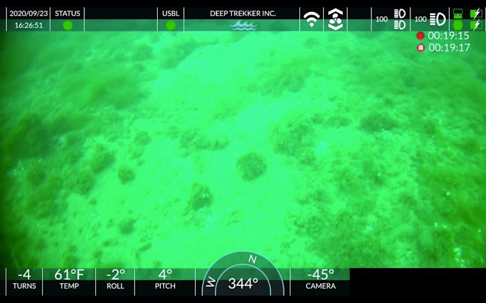 An underwater image taken by a remote-operated vehicle in the Straits of Mackinac on Sept. 23, 2020, shows a series of vegetation-covered rocks that appear relatively evenly spaced and in a somewhat linear placement. The group behind the Straits exploration believe it could be evidence that the rocks are human-placed, which would mean it occurred when the area was last above-water, around the end of the Ice Age some 10,000 years ago.